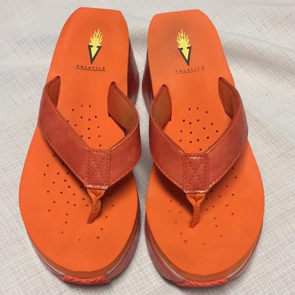 Orange Volatile sandals/flip flops.